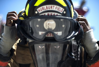 FIREFIGHTER IN FULL HELMET